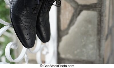Groom's shoes in Italian street outdoors