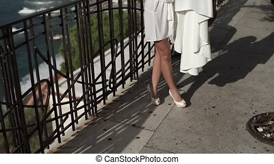 Bride's shadow with wedding dress at sunny day