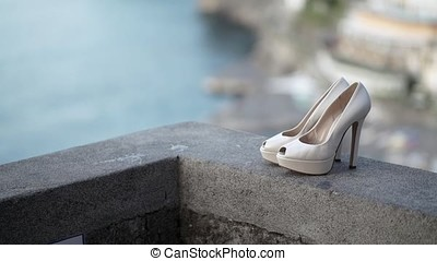 Wedding bridal shoes in a street outdoors