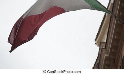 Italian flag at windy day - Italian flag at windy cloudy day
