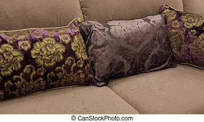 Pillows on sofa in apartment shot