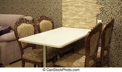 Table and chairs in apartment shot
