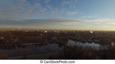 Aerial view cityscape at sunny autumn day
