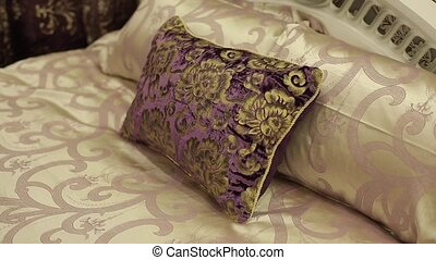 Pillow on bed in bedroom shot