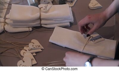Decorating napkins for wedding at cloudy day