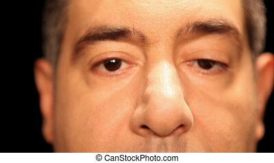 Mans face, extreme close-up of eyes - Front View - Selective...