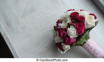 Bridal bouquet with white and red roses indoors