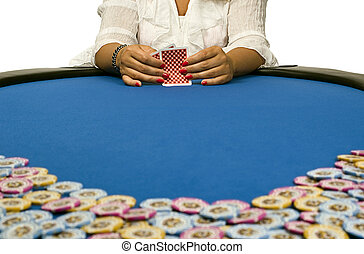 Woman holding playing cards on blue felt table with chips -...