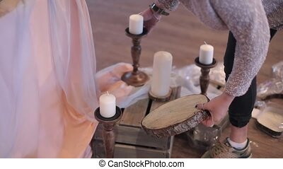 Decorating wedding candles at cloudy day