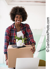 Black girl moving in the new apartment - Beautiful African...