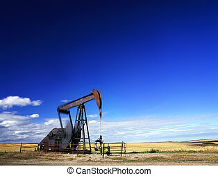 Pumpjack in action - An oil well with the pump jack in...