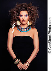 Beautiful Woman Fashion Model with Curly Hair, Makeup and Accessories in the Ethnic style