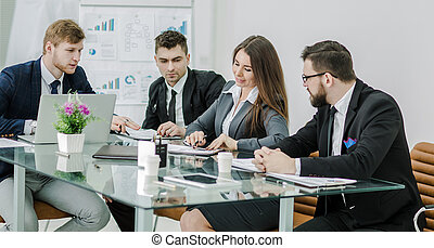 successful business team is preparing a presentation of a new financial project
