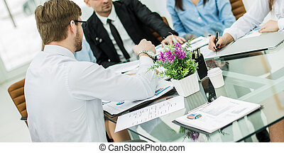 successful business team discussing a new contract at the workplace in the office.