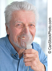 Sick elderly man makes inhalation - Portrait of a sick...