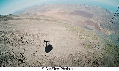 View from a ropeway cabin to volcano. The shadow of cablecar...