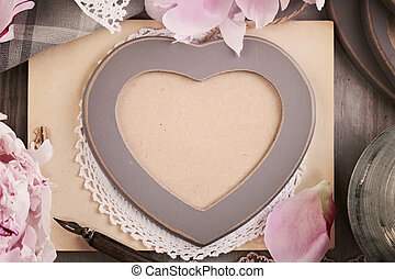 Wooden Heart Frame and Peony Flowers on Vintage Background. Retro Photo Album Cover