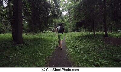 Man jogging in park shot