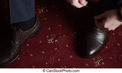 Man wearing shoes, tie the laces shot