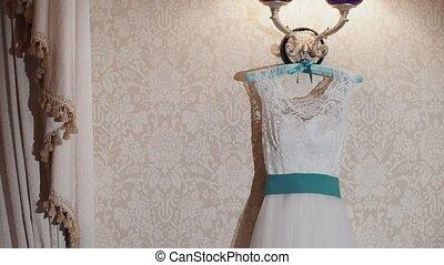 Wedding dress with turquoise belt shot