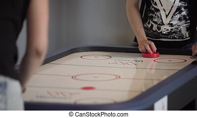 Air hockey players unrecognizable shot