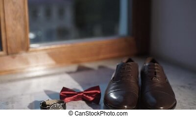Man's accessories: shoes, bowtie, watch, cuff links - Man's...