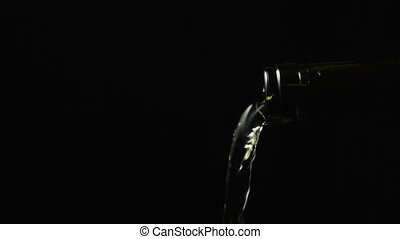 Slow motion pouring from a bottle of white wine