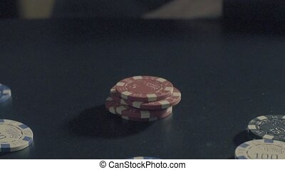 Man's hands showing tricks with poker chips - Tricks - Man's...