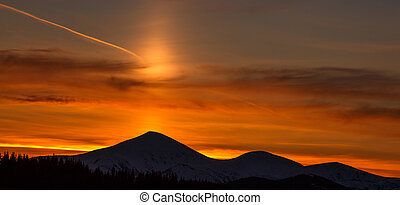 Majestic sunset in the mountains landscape. Dramatic sky.