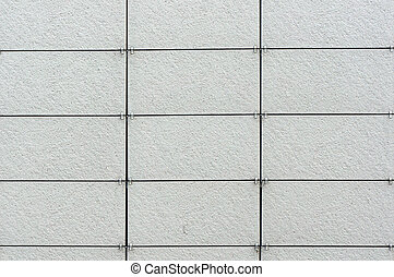 Wall coated with facing panels. Architectural background. -...