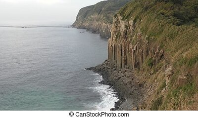 Seaside cliff - Pillar rock wall of seaside cliff in...