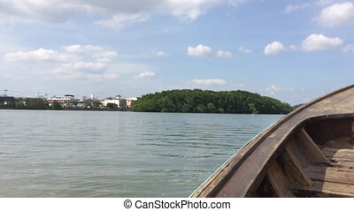 Riding on a small wooden boat