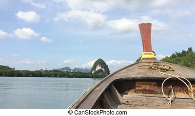 Riding on a small wooden boat shot