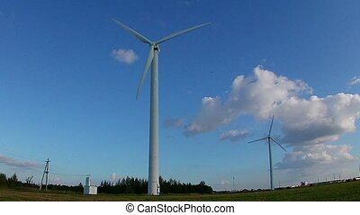 Wind generator at sunset - Wind generator on blue sky....
