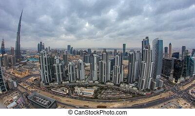 Beautiful panoramic skyline of Dubai day to night timelapse,...