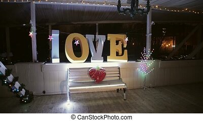 Love sign and heart of flowers at night