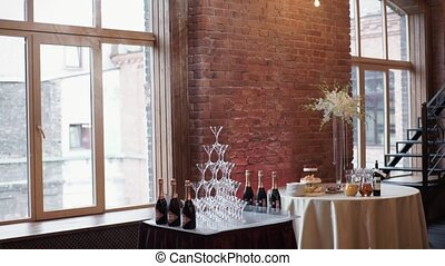Pyramid of champagne on party indoors