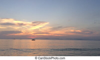 Boat in a sea at sunset