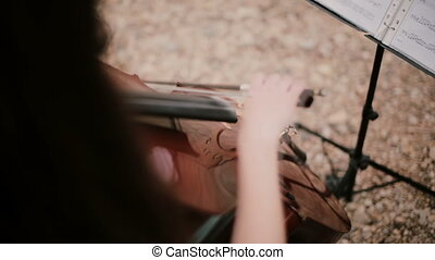 Top view of woman plays the violoncello. Young cellist...