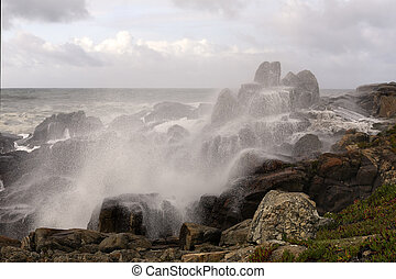 Sea water spray covering rocks from the coast - Beautiful...