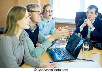 discussion of workers at the desk business ideas