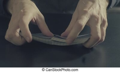 Man's hands shuffing cards. Pocker game - Poker game -...