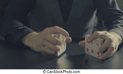 Poker game. Man's hands shuffing cards