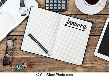 January, English month name on paper note pad at office desk