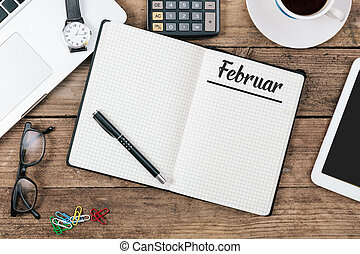 Februar (German February) month name on paper note pad at...