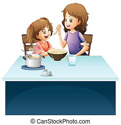 Mother feeding little kid on the table