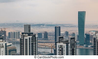 Dubai's business bay towers before sunset timelapse. Rooftop...