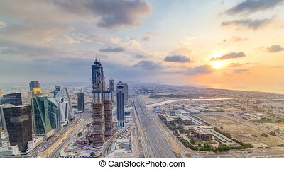 Dubai business bay towers with sunset timelapse. Rooftop...