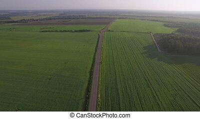 Flying over the roads among green fields, Russia - Aerial...