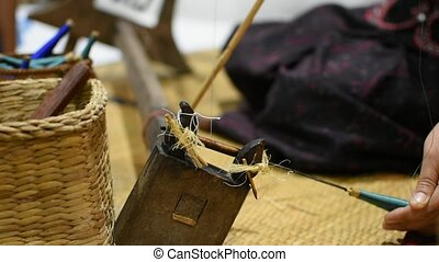Weaving silk fabric for traditional silk cloth - Asia woman...